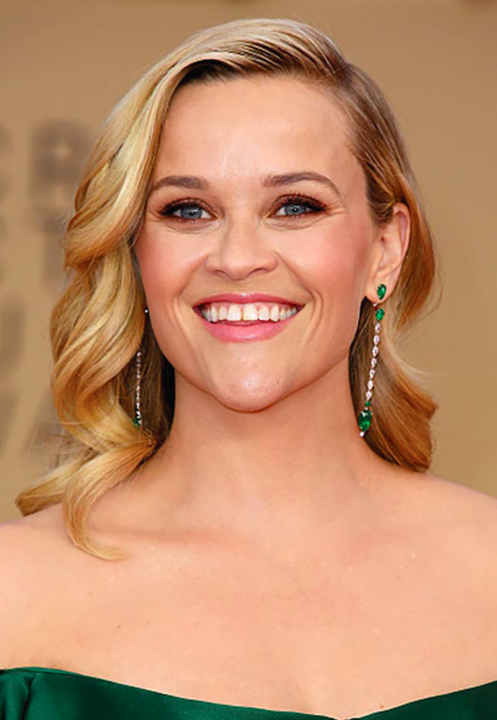Reese Witherspoon in a Zac Posen dress with complementing emerald and diamond earrings.