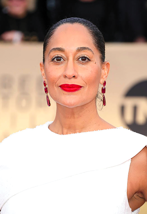 Tracee Ellis Ross in a Ralph & Russo dress with 100 carats of ruby, spinel and rubellite earrings.