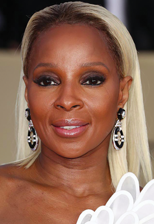 Mary J. Blige in a Jean Louis Sabaji black and white gown with diamond, black onyx and black emerald earrings.