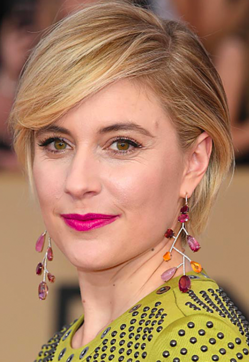 Greta Gerwig in a Bottega Veneta dress with multi-gem dangling earrings.